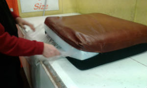 tear the upholsterers silk to let the air in to the cushion